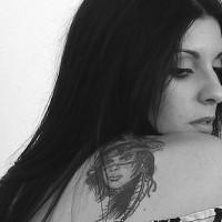Mystic warrior girl tattoo on shoulder