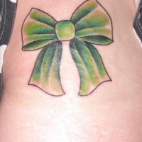 Green girly bow tattoo