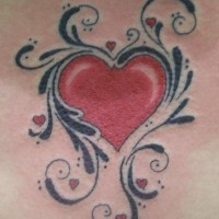 Red heart with black pattern tattoo