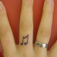 Musical note finger tattoo