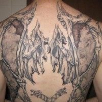 Demon wings tattoo on back
