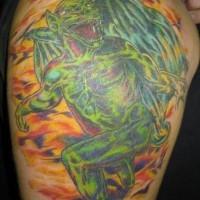 Green gargoyle in move colourful tattoo