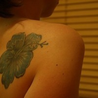 Pale blue hibiscus tattoo