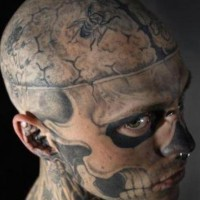 Zombie boy head and face tattoo