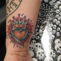 Crowned heart wrist tattoo in colour