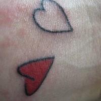 Two hearts wrist tattoo