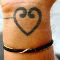 Heart on wrist tattoo