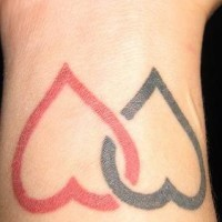Red and black hearts wrist tattoo