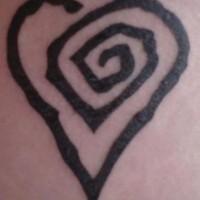 Heart shaped butt tattoo