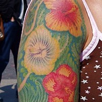 Hibiscus flowers on green background shoulder tattoo