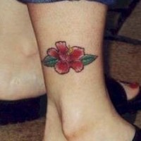 Red hibiscus flower leg tattoo