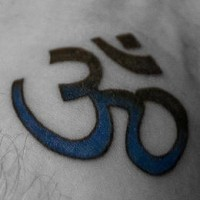 Blue and black om symbol tattoo