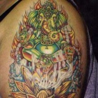 Green flaming ganesha on lotus tattoo