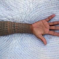 Hindu pattern sleeve tattoo