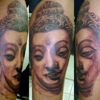 Stoned buddha face tattoo