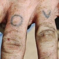 Homemade love knuckle tattoo