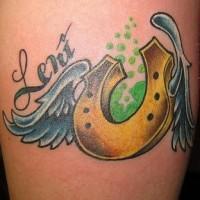 Winged golden horseshoe tattoo