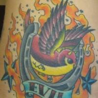 Horseshoe and evil sparrow tattoo