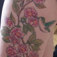 Hummingbird on pink roses tattoo on hip