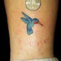 Tiny classic hummingbird tattoo