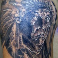 Old indian chief in feather crown tattoo