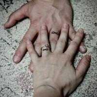 Infinity symbol ring finger tattoos