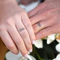 Infinity symbols wedding ring tattoos