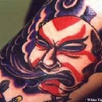 Japanese demon on purple background tattoo