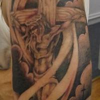Gesu sul crose in nuvole tatuaggio