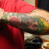 Jesus portrait colourful arm tattoo