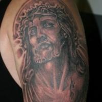Jesus in pain black ink tattoo
