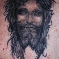 Jesus with closed eyes portrait black ink tattoo