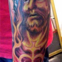 Full sleeve colourful tattoo of jesus in flame