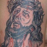 Jesus in crown of thornes with blood black tattoo