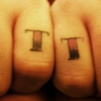 Knuckle tattoo, just time, big shaded words