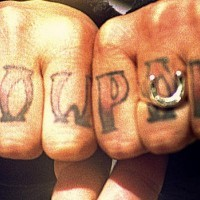 Knuckle tattoo, show pony, big designed inscription