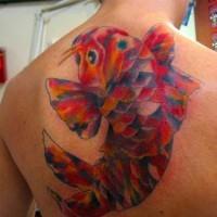 Colourful mosaic koi tattoo on back