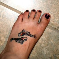 Small koi fishes tattoo on foot