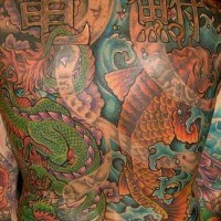Asian koi fish back piece tattoo