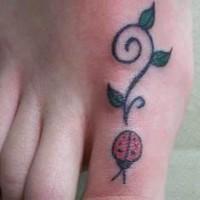 Lady bug tattoo on big toe