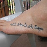 Vita brevis ars longa tattoo on foot