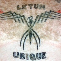 Letum ubique tribal tattoo