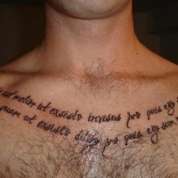 Latin text tattoo on chest