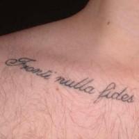 Fronti nulla fides tattoo on collarbone