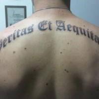 Veritas et aequitas tattoo on back