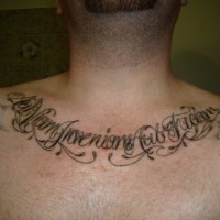 Latin lettering tattoo on chest