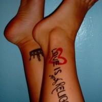 Leg tattoo, love is relegion , crown, heart