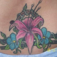 Lily blossom on zodiac symbol tattoo