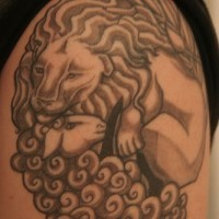 Lion and sheep tattoo in black ink