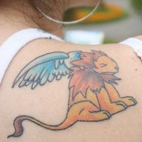 Small winged lion on shoulder